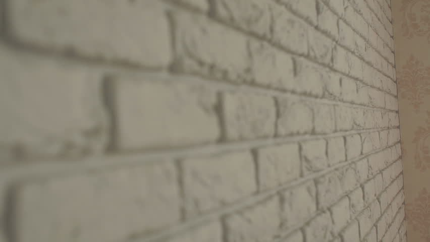 Decorative white brick wall close-up, the front background is blurred. White brick wall, background. Texture.