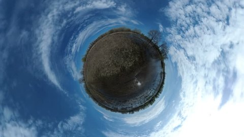 Tiny Little Planet 360 Degree - a lake and flooded land in the spring. Landscape panorama.