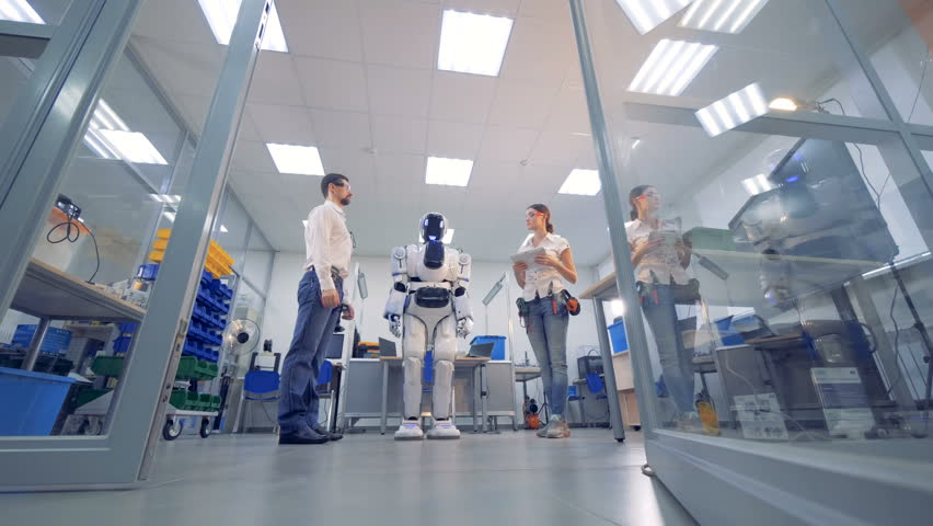 Human-like cyborg is being remotely controlled and moving in accordance with directions  | Shutterstock HD Video #1010890745