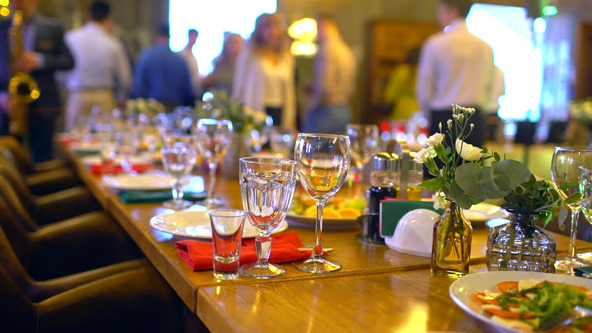 decorated table for a wedding dinner. Elegant banquet tables prepared for a conference or a party, banquet table set for an event. Served banquet table in the restaurant. slow-motion