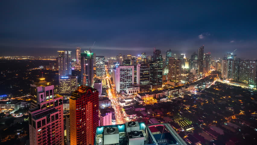 Manila, Philippines - December 12, 2017: Manila Timelapse view showing city skyline at Burgos area and view over exclusive Bel Air village at night | Shutterstock HD Video #1010896295