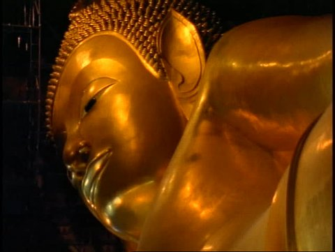 THAILAND, 1999, Temple of the Reclining Buddha, The Golden Buddha, close up face of gold