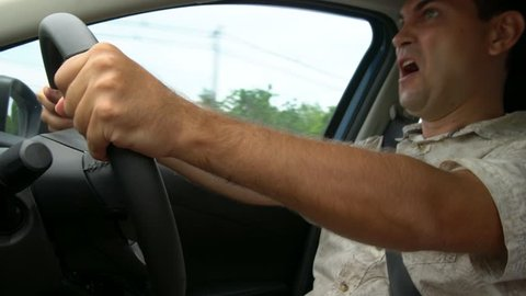 Crazy Angry Man Annoyed While Driving a Car. Mad Agrressive Driver Screaming Irritated with Traffic