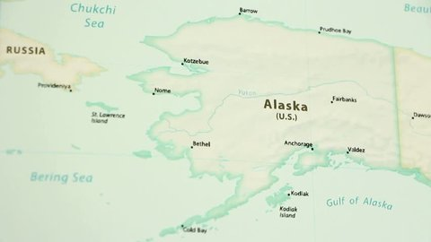 Alaska on a political map of the world. Video defocuses showing and hiding the map.