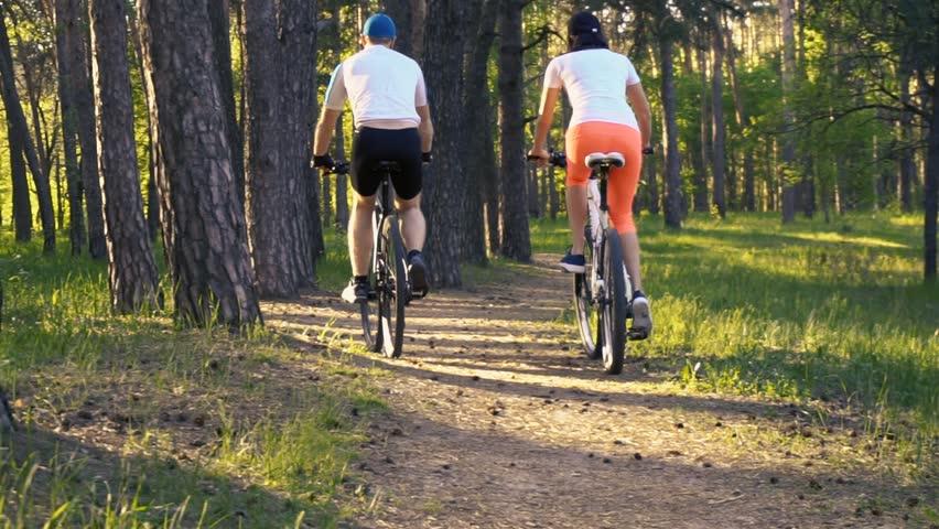 Mountain biking - Man and woman with bikes enjoy summer vacation. | Shutterstock HD Video #1010946965