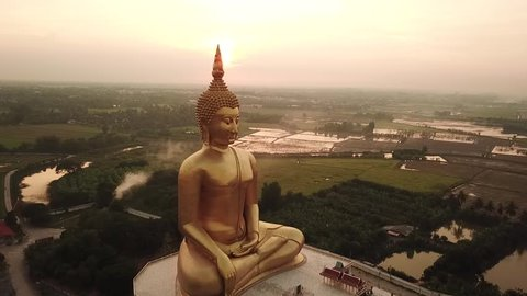 Thailand Wat Ang Thong Golden buddha statue drone footage view sunset