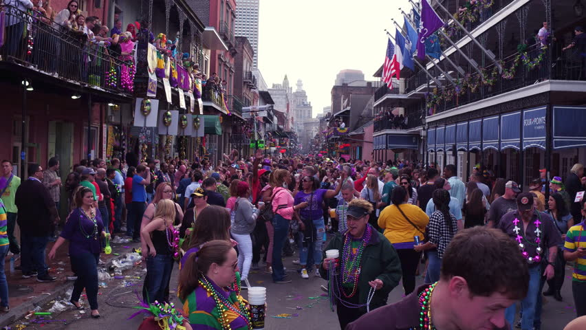 NEW ORLEANS, LOUISIANA - FEBRUARY 9:Busy Mardi Gras Bourbon Street during celebration on February 9, 2018, in New Orleans, Louisiana.