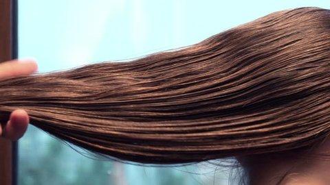 Combing long Hair, close up
