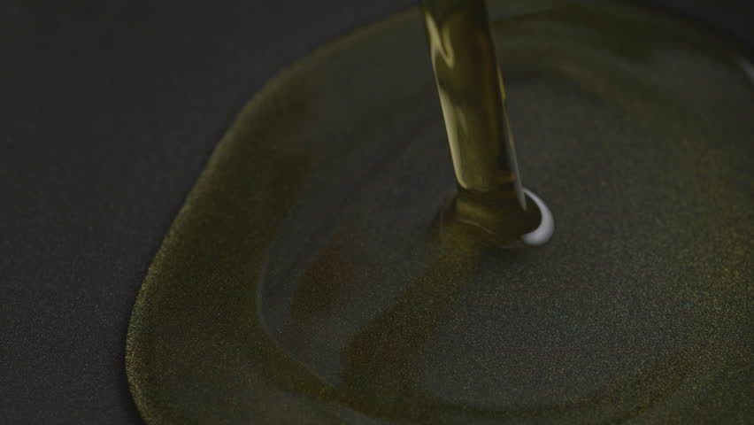 Pouring oil over fry pan. Shot with high speed camera, phantom flex 4K. Slow Motion.