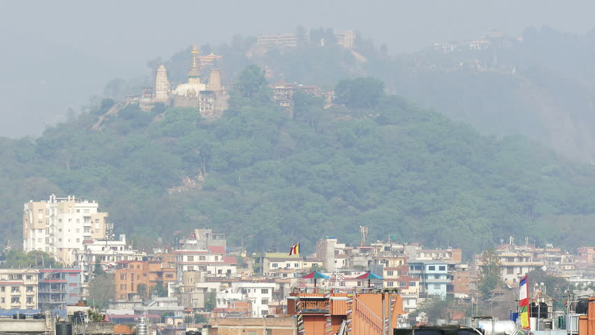 KATHMANDU, NEPAL - APRIL, 2018: architectural features of Kathmandu city at the foot of the hill with Swayambhunath monastery in Nepal on April, 2018.
