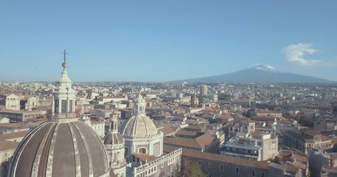 Beautiful aerial view of the Catania city with main Cathedral and Etna volcano on the background. Amazing old town view.