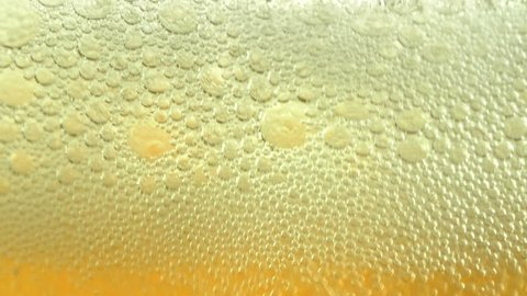 Close up of carbonated drink beer being poured in a glass