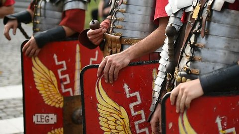 Reenactment detail with roman soldiers uniforms from the thirteen Gemina legion