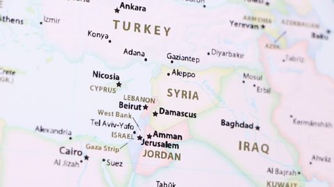 Syria on a political map of the world. Video defocuses showing and hiding the map.