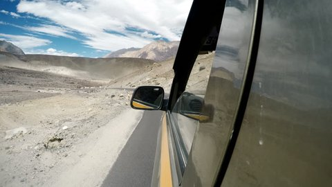 Leh - Nubra Valley road in Nothern India, Ladakh region. SUV car goes by the serpentine road.