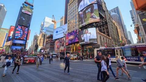 NEW YORK CITY - SEPTEMBER 2016: Timelapse of Times Square traffic and pedestrians at rush hour in New York City, USA.