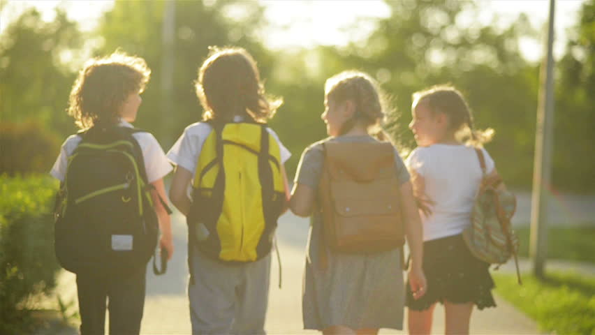 Four Friends Are Going to School. They Have A Lot of Fun Because Today is Their First Day at School.