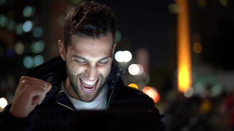 Guy Having Good News on tablet