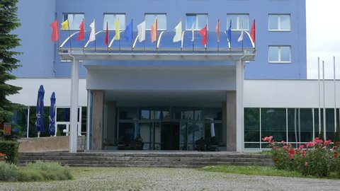 Czech Republic hotel Ontario entrance, close up shot with multiple flags waving outside