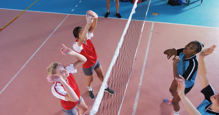 High angle view of female volleyball players playing volleyball in the court 4k