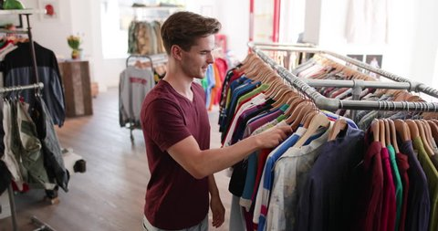 Young adult male clothes shopping