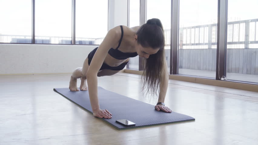 Woman Fitness Push-ups Indoors at Luxury residential Real Estate