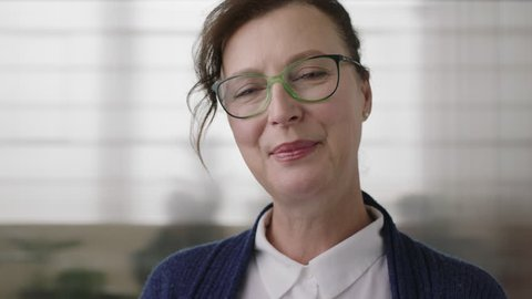 portrait of happy mature business woman executive smiling cheerful enjoying successful career leadership milestone senior caucasian female wearing glasses close up