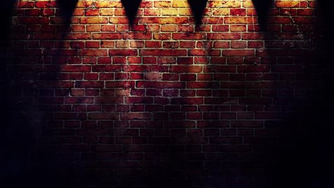 Footage of red brick wall with spotlights