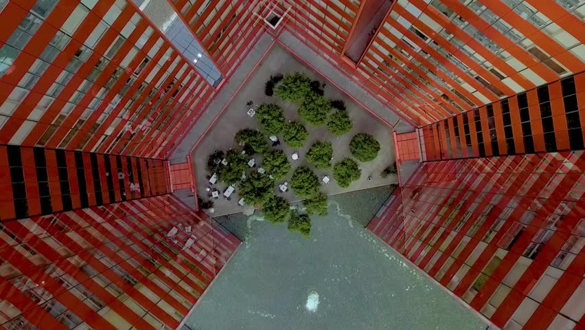 MEXICO CITY - February 22, 2018: top view of a very high office and apartment building with a central courtyard full of small trees in Santa Fe