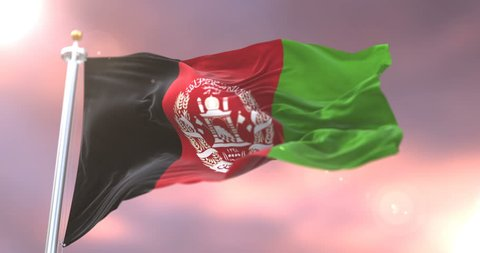 Afghanistan flag waving at wind in slow at sunset, loop