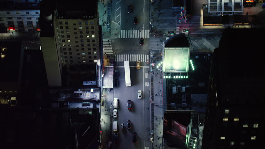 Top-down aerial view of busy street in city at night. Flying over streets in New York. Shot with a RED camera. 4k footage.
