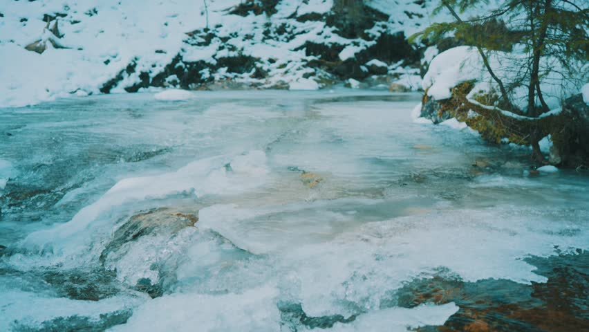 Mountain river on snowy sunny day at winter time   Shutterstock HD Video #1011337685