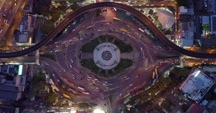 4K. Aerial view of huge roundabout and traffic lights at Victory Monument during the night time. Landmark of Bangkok, Thailand #1011352985