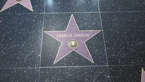 Hollywood, CA, USA - 05/15/18: Hollywood Walk of Fame Star with Charlie Chaplin (Charles Chaplin) name. Wide and Close-up Detail. For editorial purposes. Commercial use requires approval.