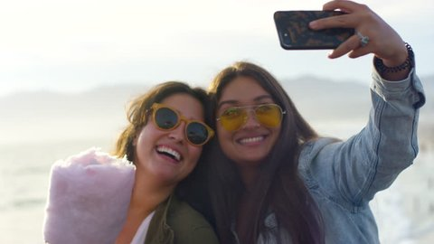 Closeup Of Friends Taking Cute Selfies With Their Cotton Candy On The Santa Monica Pier, CA (Shot On Red Scarlet-W Dragon In 4K, Slow Motion)