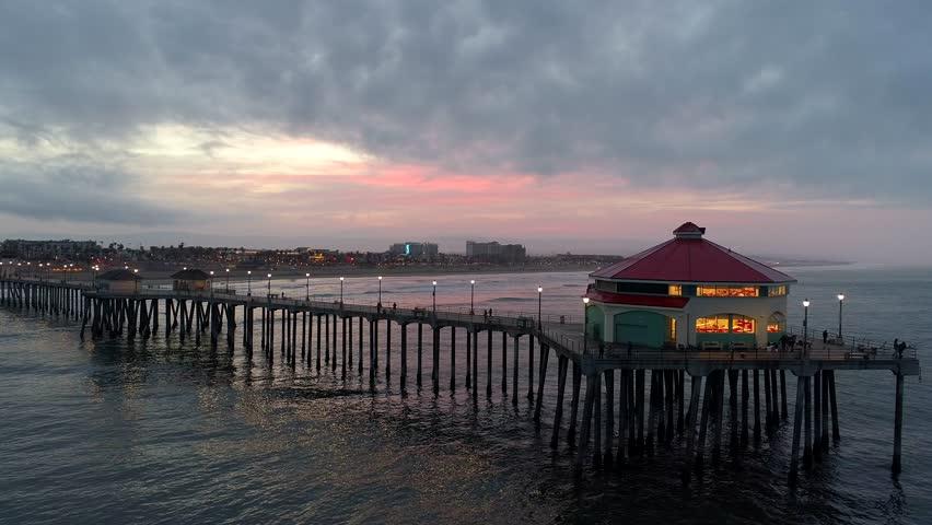 Aerial view of Huntington Beach Pier in Orange County, California at sunrise.
