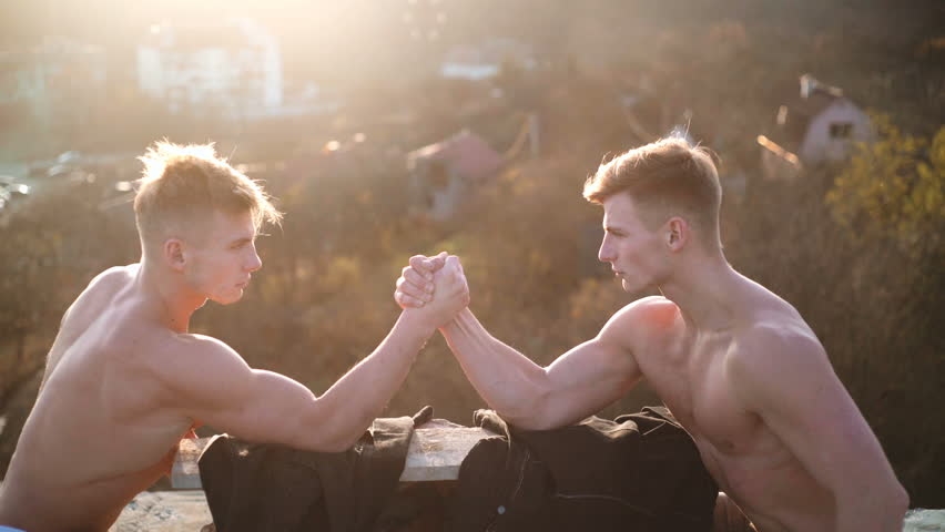 Two men arm wrestling. Arms wrestling, competition. Rivalry concept - close up of male arm wrestling. Leadership concept. Rivalry, vs, challenge, strength comparison.