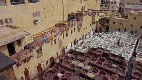 Panorama of tanneries in Fes, Morocco, Africa. Old tanks with color paint for leather, 4k