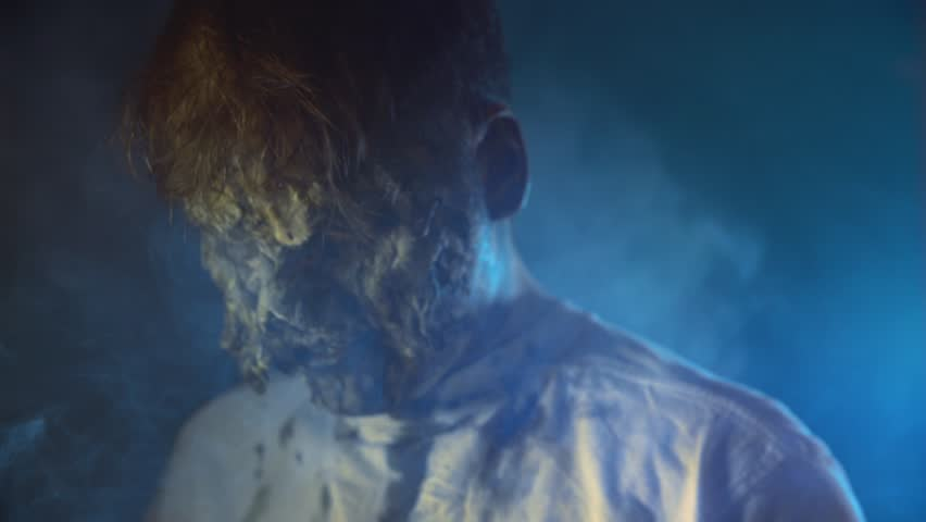Scary zombie closeup on dark background in Halloween makeup | Shutterstock HD Video #1011440105