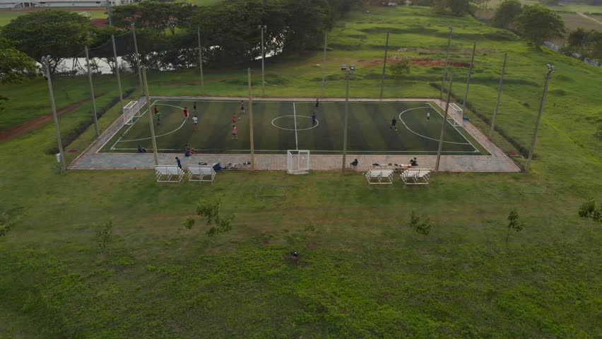 Outdoor futsal, soccer court with players at both team in public university