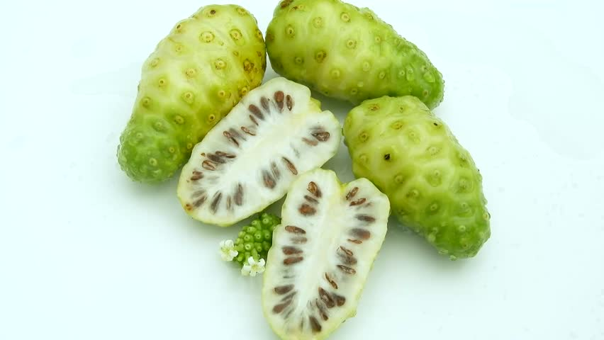 Top view fresh noni fruit on white background and poring water clips | Shutterstock HD Video #1011458165