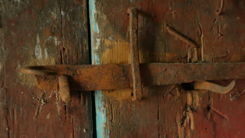 The lever opens the door latch, the door opens.