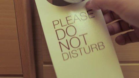 hanging card, do not disturb information on door handle in hotel room