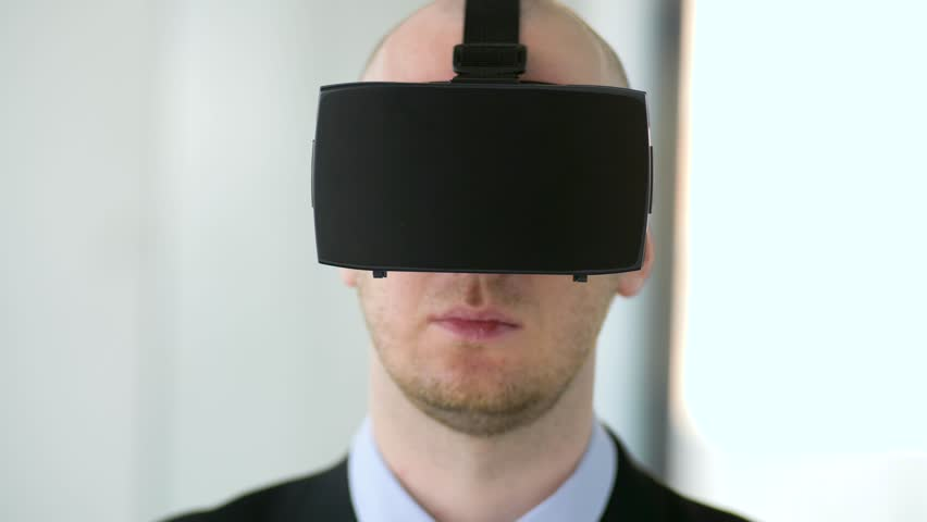Business, technology and augmented reality concept - businessman with vr headset at office | Shutterstock HD Video #1011463175