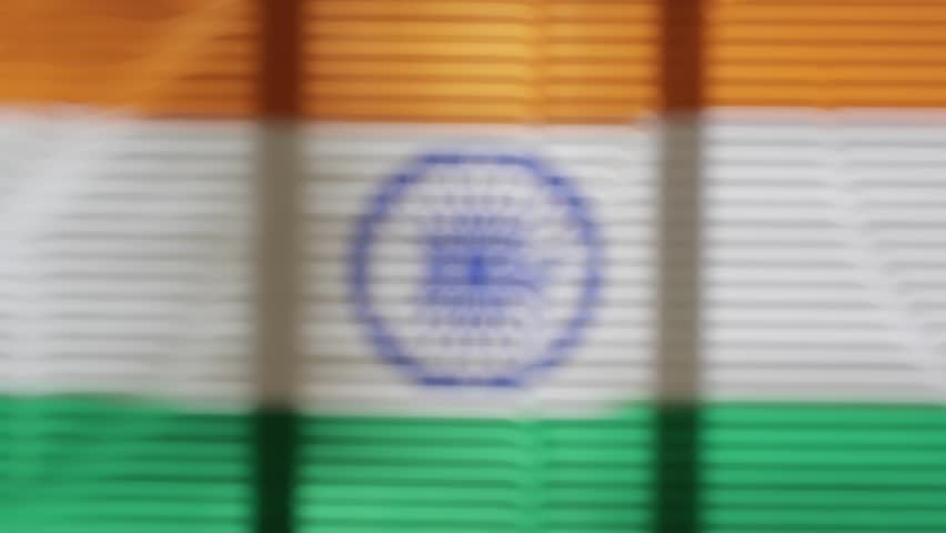 Hanging flag of India at wide jalousie window | Shutterstock HD Video #1011468785