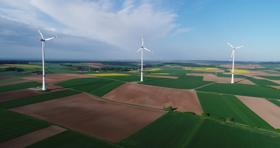 Air panoramas of agricultural fields and wind generators producing electricity. Modern technologies for obtaining alternative wind energy. Aerial view. | Shutterstock HD Video #1011476975