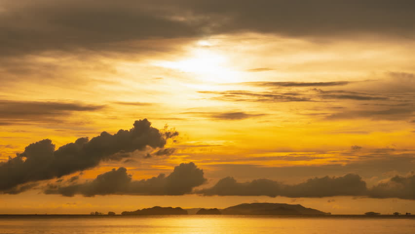 Time lapse twilight sky and cloudy evening at island beach, ranong, thailand.