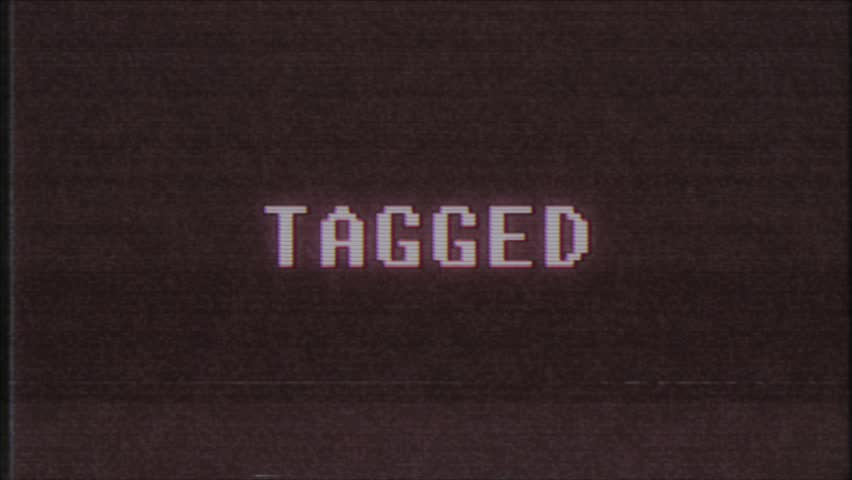Retro videogame TAGGED word text computer tv glitch interference noise screen animation seamless loop New quality universal vintage motion dynamic animated background colorful joyful video m   Shutterstock HD Video #1011505925