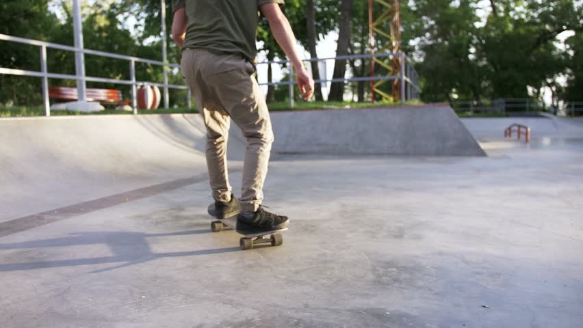 Skateboarder doing a tricks in a concrete skate park, close up, slow motion | Shutterstock HD Video #1011510035
