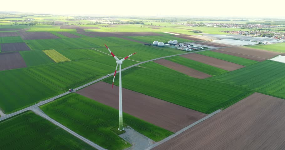 Aerial view of wind turbine, A view of the wind generator on the background of panoramas of green fields and meadows, around, wind power in agriculture, UHD, 4K | Shutterstock HD Video #1011518315